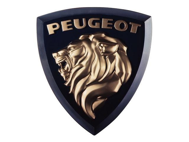 Los leones Peugeot – Un estilo más moderno, también en dorado, para el 404 en 1960